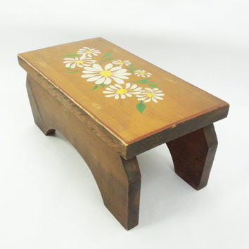 Vintage wooden footstool with painted white daisy flowers