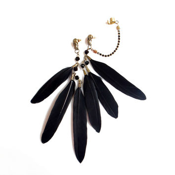 Black feather ear cuff earrings with skulls