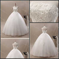 A-line tulle with appliques strapless wedding dress