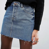 ASOS Denim Low Rise Pelmet Skirt in Freesia Mid Stonewash with Raw Hem at asos.com