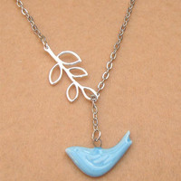 Leaf and Porcelain Bird Necklace by turquoisecity on Etsy