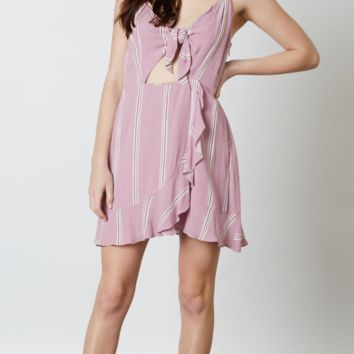 Mini dress featuring a tie-front detail and ruffle skirt in Pink