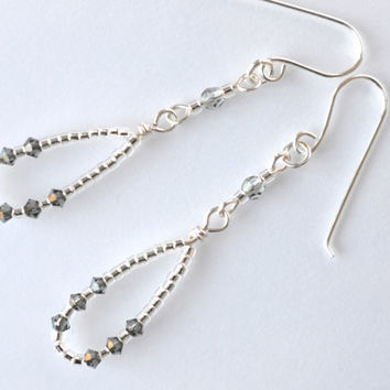 Beaded dangle earrings with Swarovski crystals and seed beads. Silver dangle earrings.