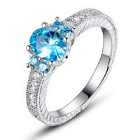 Sterling Silver Ocean Blue Oval and Round Cubic Zirconia Engagement Ring