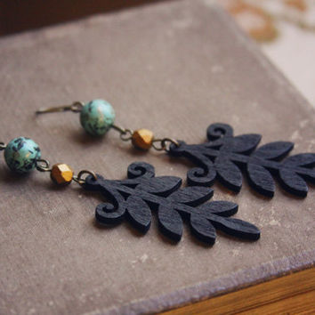zara.  a pair of black wooden leaf earrings. by RootsandFeathers