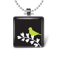 black glass tile pendant, green bird silhouette on branch