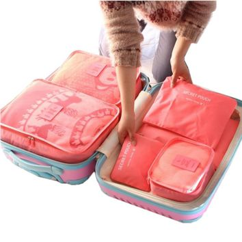 Six Piece Set of Large Capacity Packing Cubes to Organize your Travel Bag