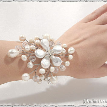 Pearl bracelet with crystals and rhinestone beads. Perfect for brides , bridesmaids , prom corsage or for a gift . Hand-wired