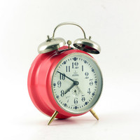 Vintage pink desk alarm clock with twin bells