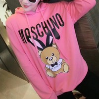 """Moschino"" Women Casual Fashion Letter Cute Cartoon Rabbit Bear Print Hooded Long Sleeve Pullover Sweater Sweatshirt Tops"