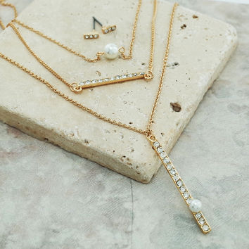 Multi layered pearl and bar pendent necklace and earrings