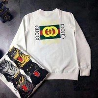 GUCCI : Four tiger leopard head sweater sleeve head