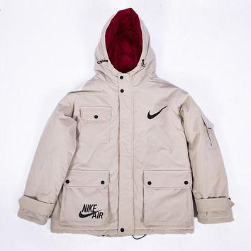 NIKE winter new hooded big pocket men and women models cotton coat tooling cotton clothes white