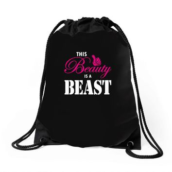 This Beauty Is A Beast Drawstring Bags