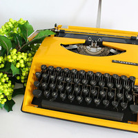 Adler Tippa yellow working condition portable small typewriter with original case
