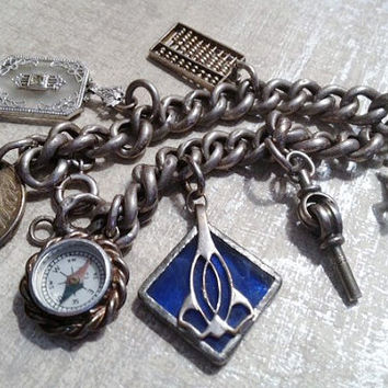 VINTAGE Curb Link Charm Bracelet Art Deco Horse Compass Watch Key Blue Glass Sterling Silver 1951 German Coin Seven CHARMS Sterling- tt team