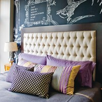 Chalkboard and tufted headboard