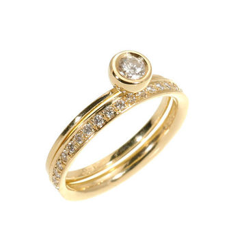 Elegant and Simple Diamond Set Ring - Solitaire 0.25 carat Diamond Ring and Full Eternity 0.22 carat Diamond Band Together.