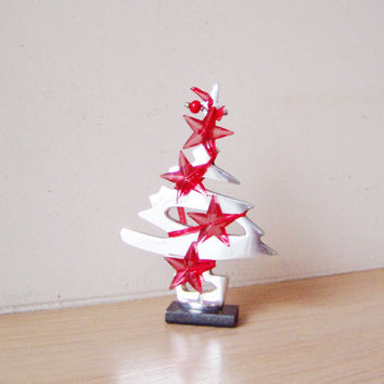 Tiny Chritmas tree sculpture, aluminum Xmas tree miniature on a brass base with red stars garland trim, red and silver Christma tree