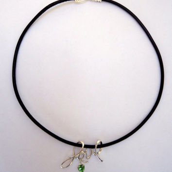 "Black leather choker necklace with sterling silver  ""Love"" slider bead and peridot heart swarovski charm."