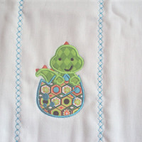 Embroidered burp cloth with an applique baby dragon in an egg. Can be personalized for an extra charge.