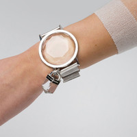 FIDDY-CENT QUARTZ WATCH
