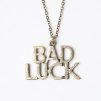 GOLD BAD LUCK NECKLACE