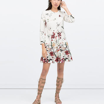 PRINTED FRONT PLEAT DRESS WITH POCKET