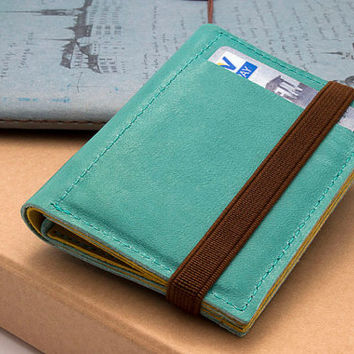 Designed leather wallet, Enclosed by elastic band, one of a kind portemonnaie, made of up cycled leather