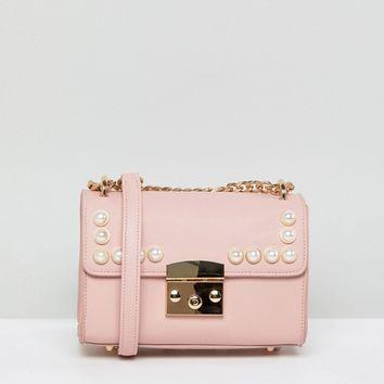 London Rebel Pink Pearl Acrros Body Bag at asos.com