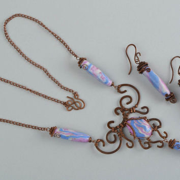 Earrings and pendant made of copper and polymer clay using wire wrap technique