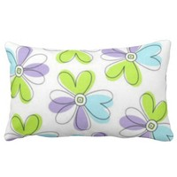 White pillow with colourful flowers