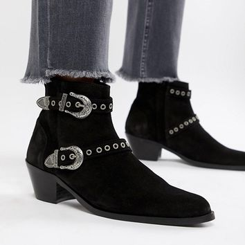ASOS DESIGN stacked heel boots in black suede with silver western buckles at asos.com