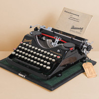 1935 Rheinmetall KsT Typewriter. Restored. Excellent working condition. German portable vintage typewriter. Glossy black. Case.
