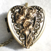 Music box locket,  heart shaped  locket with music box inside, in bronze with bronze filigree and iris on cover
