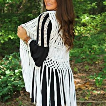 The Second Coming Vest in White is perfect to add over your favorite tank or shirt. It is a sleeveless vest with a spaghetti string diamond detailing throughout with string fringe. Made from 95% Rayon & 5% Spandex.