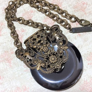 Jan Michaels Glass Disk Necklace Black Hematite Attached Pendant Ornate Filigree Brass Tone Setting 418