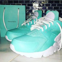 Nike Huarache Tiffany with white sole and strap unisex customs.