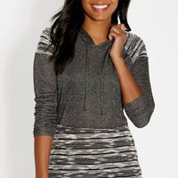 hooded pullover with metallic shimmer and rhinestone embellished shoulders