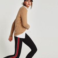 LEGGINGS WITH PIPED SIDE STRIPES DETAILS