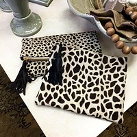 Lyn Tassel Cowhide Black, Animal Print, Light Tan Clutch Handbag