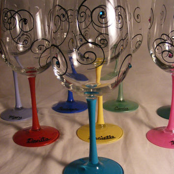 large painted wine glasses in assorted colors with Swarovski crystals. Can be personalized for birthday or bridesmaids