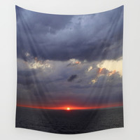 Red sunrise. Mediterranean sea Wall Tapestry by Guido Montañés