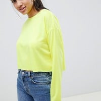 ASOS DESIGN crop boxy t-shirt with long sleeves in neon at asos.com