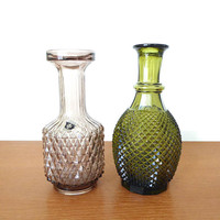 Two vintage jewel toned diamond point decanters