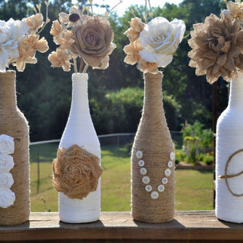 Upcycled jute / twine / yarn wrapped wine bottles featuring handmade roses spelling out 'Love'
