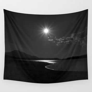 Mystery sun. Sunrise over the lake Wall Tapestry by Guido Montañés