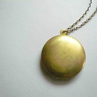 Vintage gold locket on long necklace chain. Simple and romantic brass circle locket.