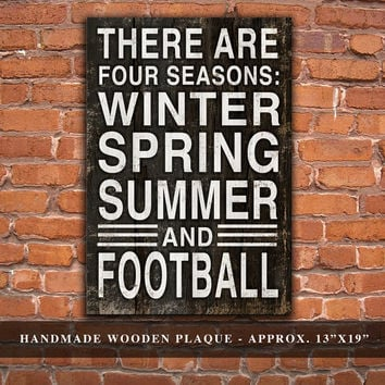 "There are four seasons: Winter Spring Summer and Football Wooden Plaque. Approx. 13""x19"""
