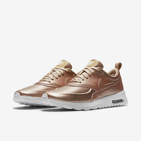 The Nike Air Max Thea SE Women's Shoe.